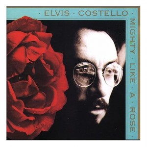 """Mighty Like A Rose"" Was Elvis Costello's First Album Of The '90s. It Had A New Collaboration With Paul McCartney Named ""So Like Candy""."