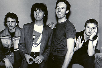 The Band With Dave Gregory (Standing Next To Colin)